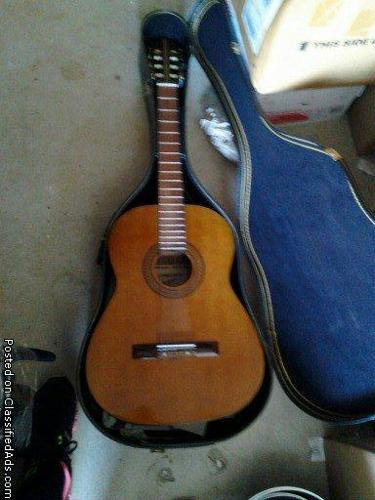 Acoustic Guitar and solid guitar case