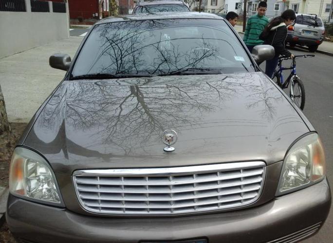 cadillac deville 2001auto miles 120.000 on it