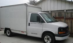 03 GCM cargo 1 ton van, 10' box with roll up gate. 68,607 miles