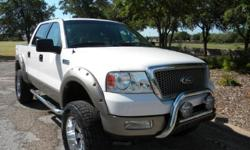 2004 Ford F-150 Lariat 4x4 Custom Lifted! This gorgeous truck is featuring white color exterior on tan leather interior! With 80k highway miles it looks very clean inside and out. It comes fully loaded with options such as power windows and lock, power