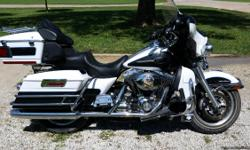 29500 miles, pearl white and charcoal metallic color. Fresh oil change in the engine, transmission and primary. Upgraded to a Baker compensator and Haden chain tensioner. 1 year old Interstate battery. Good tread on tires.Street glide style back rest to