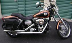 Low mileage (<3000) Copper/Black factory paint. Maintained by certified Technician. Six speed transmission. Factory security system. Detachable windshield and passenger backrest (All Harley). Backrest tilts (Just out from Harley). American Exhaust - quick