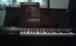 12-16 Chord Organ. Comes with book. Works perfect, bought it for the kids, but they don't play on it. It has only been played twice since i have had it. Bought it a year ago for 300.00 but willing to part with it for $50.00.