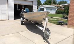 14ft Lund aluminum fishing boat,with 8hp mercury motor,24lb. Minkota electric motor, eagle fish finder,one down rigger pole holders,2 padded swivel seats.and trailer