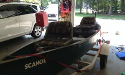 14 ft slightly used scanoe. It ways 85 lbs and is easily carried into the water. Removable seats added, and mount for an electrictrolling motor.