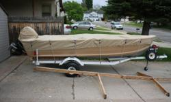 SYLVAN 14 Ft 2 In aluminum with a flatdeck with live well & storage bin also covered storage in bow VERY COMFY.The motor is a 25 hp mercury with stainless steel prop and a very good trolling plate in VERY GOOD RUNNING ORDER. The trailor