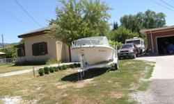 arkansas traveler boat,factory trailer, 35 hp evinrude outboad motor with electric start,6 gal fuel tank,running lights,horn and safety equiptment,fish finder,etc great fishing boat works great.