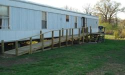 Cappart Manufactured Housing Inc Date Built: 1-31-96 4 bedroom/ 2 bathroom. Open concept kitchen and living room with 2 bedrooms on each end with a full bath also on each end. One bathroom has been modified to be bigger to accommodate a wheel chair. One