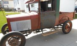 1929 Ford Model A Pickup Ford Model A Pickup. This is a grand old truck that is looking for someone to give it some TLC. She has good bones that are sound and clean enough to go to work on. The fuel tank and frame are clean. There is a new maple wood top
