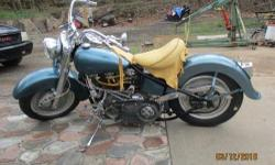 Classic Harley 1952, newly rebuilt, looks great, this is a show quality motorcycle, Teal blue with fine metal flake pearled in paint job, 3 inch BDL belt drive, Fat boy wheels, S&S carb. super E, Custom elk skin leather dash and seat, Front and back disc