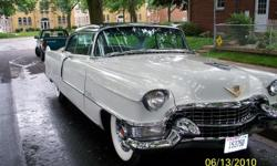 1955 Cadillac Coupe deVille A stunning ride that speaks both of luxury and a bygone era.  2-tone gray.  59,585 miles.  Excellent chrome.  Factory option sabre (turbine) wheels, bias ply wide whitewall tube tires. Rebuilt carburetor,