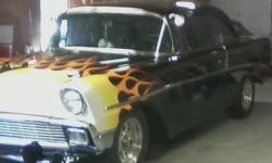350 engine, 300 transmission, 10 volt Differential, Front disc breaks, power steering , After market tilt column Straight clean body. https://www.cacars.com/Car/Chevy/210/1956_Chevy_210_for_sale_1013497.html
