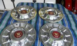 "1957 Cadillac 15"" Hubcaps $525.00 set, NEW Day Night Mirror W/Mounting Stus $60.00, 10 Cadillac Matchbook Covers $20.00"
