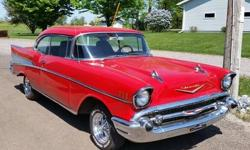 We have a very nice 1957 Chevy Bel Air 2DR hard top, with a fresh 350 and a Saginaw 4 speed. Great chrome and fresh paint. Car runs and drives awesome. The car was rear ended on the right side and we put all new metal on. This car does have a salvage