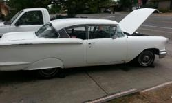 1958 chevy 2 door matching numblers running cond.very clean in side.needs work out side.drive it home---916--217--3268 clean title.