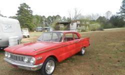 1961 Mercury Comet , 2dr. Red, in very good condition and runs good. You may call 706-401-8240, 8am - 8pm