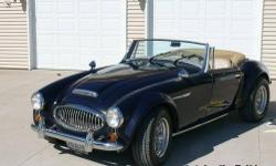 WOW! A real head-turner! Perfect way to enjoy the rest of the summer and fall. This beautiful dark blue roadster (tan interior) was built professionally by Continental Car in Winnipeg. The kit includes the body, custom made frame, convertible top,