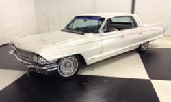 Stk#001 1962 Cadillac Fleetwood Exterior: White paint slick and straight, front & rear bumpers are nice, grill is really nice. Single outside drivers side mirror, door handles are nice. Glass looks good, original rims, fender skirts, power antenna, tail