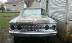 62 comet custom 2 door sedan project.no motor or tranny.all good glass.all but one piece of trim is there.9 inch rear end.very solid car.its about 90% complete. its a pretty rare car I have only seen 2 in my whole life. well worth what I'm asking.tittle