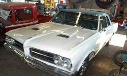 1964 PONTIAC GTO, Convertible.....Some of the pix that you see on line are the before painted pix...... we have just given it it's first paint job with a new top and like new interior looks great..........with new bumpers, all new accent chrome......