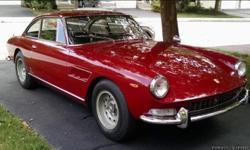 This 1967 Ferrari 330GT 2+2 Series II single-headlight car is a matching numbers example just out of 40 year ownership. Red with black leather interior that's almost like new. It's a very late Series II car with a high chassis number (only about 25 left