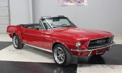 Stk#107 1967 Ford Mustang Convertible Painted a beautiful Red BC/CC paint. The Rocker panel moldings are like new. The door handles and wheel well moldings are like new. The front and rear bumpers, tail lights, gas cap, rear trim are all like new. The