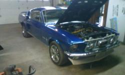 1967 Ford Mustang fastback. 87000 miles. came with 289 has a 302 in it. Cobra package. Blue metal flake paint with white racing stripe. Runs great!!! Sounds even better!!! 25,000.00 or best offer. Call -- for showing.