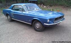 I have a 1967 Mustang coope that fires right up. It has the original in line 6 motor with 108k miles, and an automatic transmission. The interior is in great condition, it is black and blue leather. The beautiful blue body is straight besides a few rust