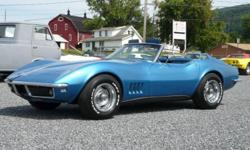 Truly a classic car! This 1968 International Stingray Corvette has a gorgeous blue exterior, blue interior, and a white convertible top.  This corvette just had new seat covers, carpet, rear tray installed along with oil and filter changed,
