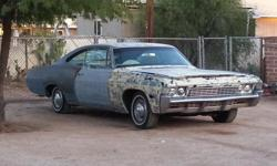 FOR SALE A 1968 CHEVY IMPALA FASTBACK REBUILT 307,RUNS AND DRIVES GOOD NEEDS BATTERY AND PRIMER. OVERALL COMPLETE CAR WITH LOTS OF EXTRA PARTS.