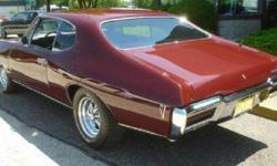 PHS Documented 1968 GTO Hard Top Rebuilt 400 Four Speed.......Custom Chrome Cragar SS Wheels.......New Burgundy paint original (Matching Vin Tag Colors).......Check it out you will be impressed with this SOLID CLASSIC and a Great Investment!!!!!