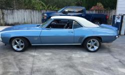 Get ready to rev your engine for this 1969 Chevy Camaro Super Sport/Rally Sport Coupe! This two-door pony car features a strong, athletic styling that has become an icon of pure American made muscle. This Camaro comes dressed to impress with Blue