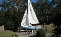 Fair condition, rigging complete with main, genoa, spinnaker. Trailer included, no motor.