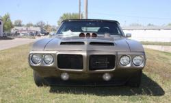 Big block v-8, automatic, custom paint job, lots of custom work done to this one ! Delivery at your doorstepis available. Exterior Color:Brown Interior Color:Black Transmission:Automatic Odometer:39040 Restoration History:FullyRestored Exterior