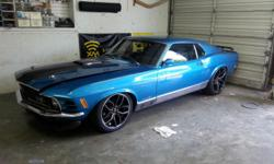 Please message me with questions at: torrietgguthridge@uk2k.com . 1970 Mach 1 Mustang. Super Nice Driver. Interior is all *NEW*. Seats, Panels, Headliner all done with Katskin and sewn with blue thread on a French seam to eliminate the piping from the