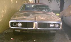 1971CHARGER 500 NO FRONT GRILLS OR REAR BUMPER OR TAIL LIGHTS. 81/4 REAREND. HAS RUST ON FLOOR PAN. FRAME IS IN GOOD SHAPE, IT HAS A 318 ENGINE & 904 TRANSMISSION THAT CAME OUT OF A 1980 CHRYSLER NEW YORKER, RAN WHEN INSTALLED. HAS NO INTERIOR OR DOOR