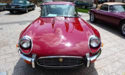 This 1973 E-Type V-12 has only 22,500 original miles from new, over 42 years ago. It has has a professional $15,000 dollar respray in the authentic Regency Red It's a gorgeous car now sporting a new complete custom installed, by hand,