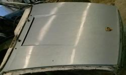 For sale is a hood off a 1976 Porsche 911. Painted in silver. Very nice condition! Call 561-301-2369 to view
