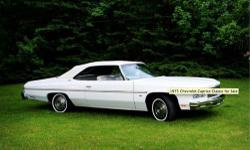 1975 Chevrolet Caprice Classic convertible, garage kept. This is a full size automobile - 20 ft long! White on white with original white bench seats that accomodate 6 people. New complimentary burgundy carpet matches the dashboard. 350 engine and