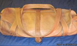 This is a Vintage, Western Style, Original and STILL VIRTUALLY NEW Leather Marlboro Man Duffel, and it is PERFECT. Only a LIMITED EDITION of these duffels were made for promoting the Marlboro Man in 1975.  I purchased this bag directly from