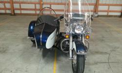 This is a 1976 Harley-Davidson FL with sidecar in blue and white. This bike is an awesome machine. It would make a great addition to anyone?s collection. Serious buyer only please.