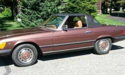 Take a step back in time with this 1976 Mercedes-Benz 450SL! This two-door convertible features a sporty and lightweight styling that is dressed in lovely brown paint and complimented by a tan buckskin interior. Powered by a 4.5 liter V-8