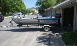 Get ready for your next outdoor adventure with this 1982 Bluefin by Spectrum Fishing Boat. This fresh water fishing boat is 14 feet in length and features an all aluminum hull. Powered by a Mercury Outboard Motor that offers 20 horsepower,