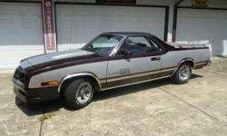Custom SS Package, Silver and Maroon Two-Tone with Maroon Bucket Sets, console and interior. 305 V8 with 200R overdrive trans. Rust Free, straight body. GM original SS Mags. Loaded with Power Windows, AC, Cruise, etc. Runs and drives great! An Eye