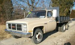 1985 GMC 3500 dump. This was a State park truck and only has 62,000 miles on it. It has a 350 motor, 4 speed transmission, power steering. The bed is 8? all steel Knapheide electric over hydraulic flat bed with removable sides. This is a great older truck