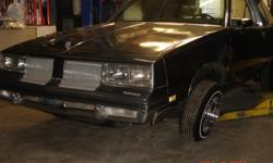 1986 Cutlass for sale, asking $2500 for the car, car is grey, car has dark & light grey leather interior, car has a v-6 motor in it that runs really really good, frame is 85% reinforced and painted grey to match the car, car has a 350 transmission in it,