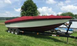 Year: 1987 Make: Checkmate Model: NA Hours: NA Interior Color: NA Exterior Color: NA 1987 Checkmate, Twin 370 HP with TRS Drives with nose cones, 73 MPH on GPS, Tri axle trailer, stove, microwave, head, refrigerator, depth sounder, new full cover, new