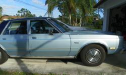 1987 Dodge Diplomat Classic Dodge Diplomat Sedan 4-door 5.2L V-8 automatic 4-door sedan body type RWD (rear-wheel drive) Original 71, 500 miles Lt Blue with Vinyl top Wedgewood Velour interior A/C New Battery Brand New Tires.  This car