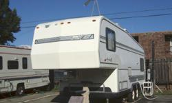 5th Wheel Trailer in good condition. 1 queen size sofa bed and 2 twin beds in the upper section, stove, oven, air conditioning/heater, bathtub with shower, electric water pump and lots of storage space.