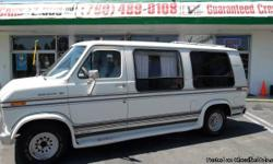 THIS IS A TRUE BLAST FROM THE PAST. FULL CUSTOM CONVERSION. 4 CAPTAINS CHAIRS, ELECTRIC RECLINING REAR SEAT TO BED. DRINK COOLER, AND ALL OF THE STUFF. WHITE EXTERIOR, ROSE INTERIOR EXCELLENT CONDITION!!! FRESH START MOTORS IS AN AMERICAN OWNED AND